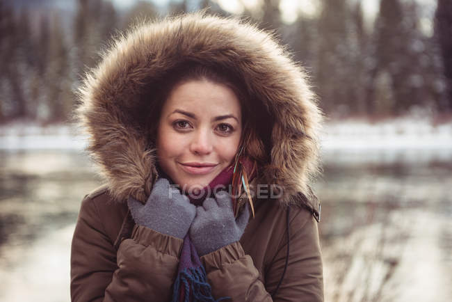 Portrait of beautiful young woman in fur coat — Stock Photo