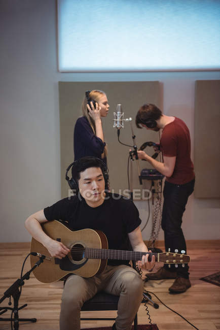 Music band performing in recording studio — Stock Photo