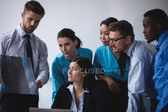 Medical team examining an x-ray report in conference room — Stock Photo