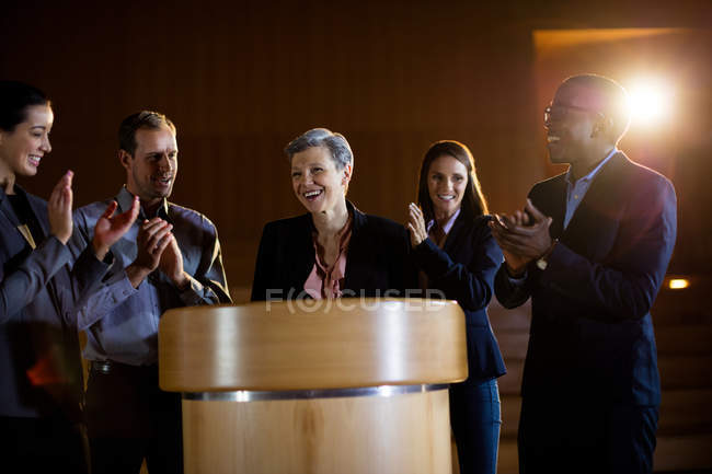 Colleagues applauding speaker after conference presentation at conference center — Stock Photo