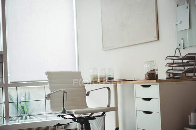 Empty chair and desk in office — Stock Photo
