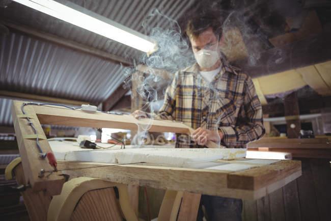 Man making surfboard in workshop interior — Stock Photo