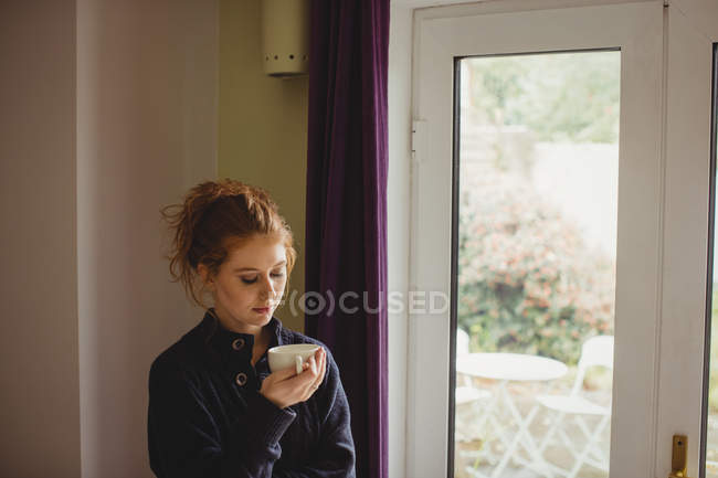 Beautiful woman having coffee at home — Stock Photo