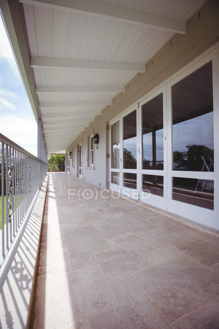 Exterior of a house with empty veranda with windows — Stock Photo