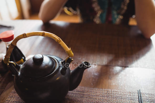 Close-up of teapot on dining table in restaurant — Stock Photo