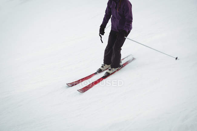 Skier skiing on the snow covered landscape in winter — Stock Photo