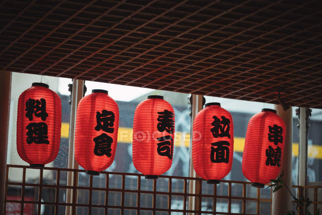 Japanese lanterns hanging in a row at restaurant — Stock Photo