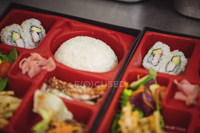 Close-up of various food in sushi tray plate at restaurant — Stock Photo