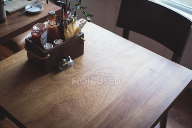 High angle view of sauce tray on wooden table — Stock Photo