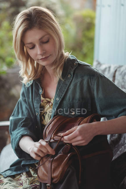 Beautiful woman packing her bag — Stock Photo