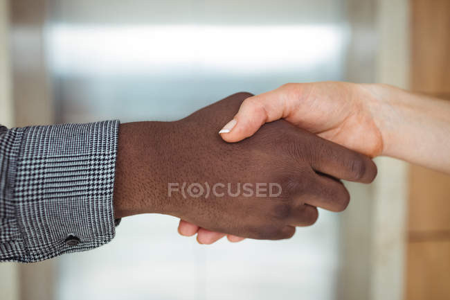 Multiracial business executives shaking hands, close-up — Stock Photo