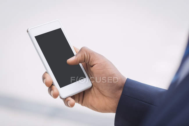 Close-up of businessman using on mobile phone — Stock Photo