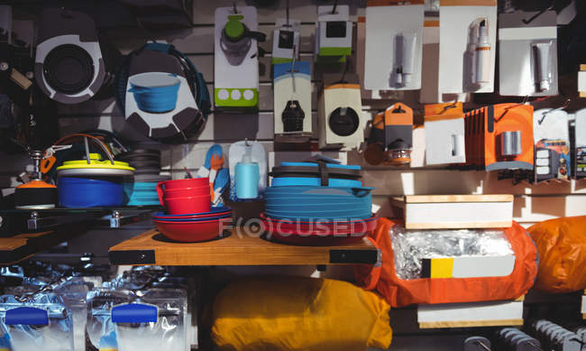 Interior of a cloth shop various items on rack — Stock Photo