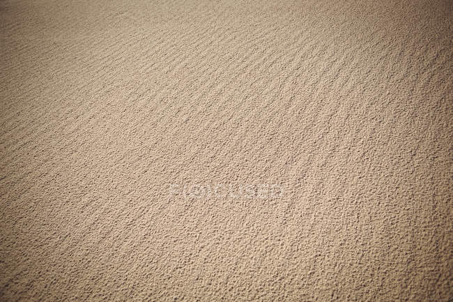 Close-up of beach sand texture and ripples — Stock Photo