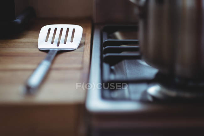 Spatula on wooden table in kitchen — Stock Photo