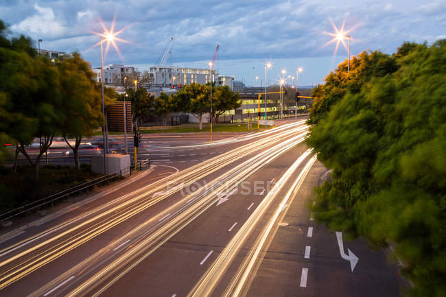 Long exposure of expressway in modern city — Stock Photo