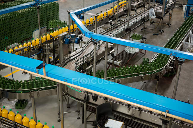 High angle view of cold drink bottles on production line in factory — Stock Photo