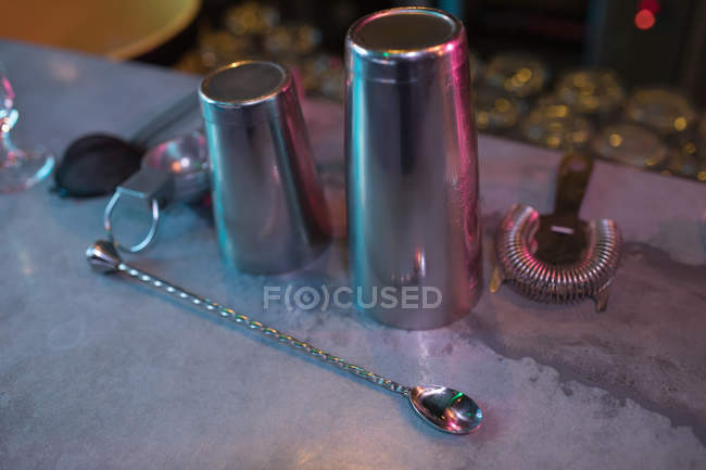 Close-up of bar accessories with cocktail shaker and spoon — Stock Photo