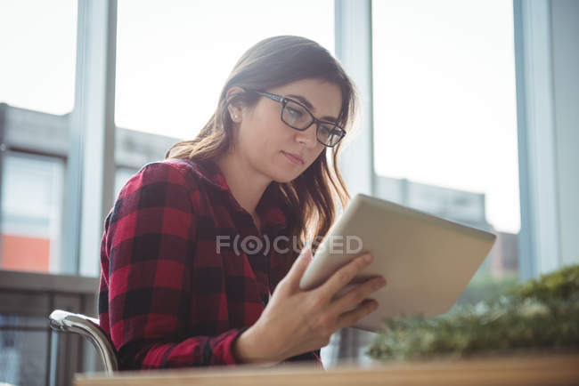 Business executive using digital tablet in office — Stock Photo