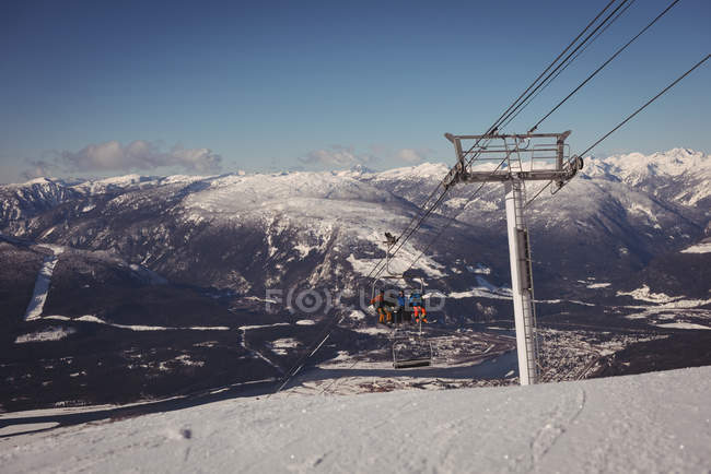Low angle view of skiers travelling in ski lift at ski resort — Stock Photo