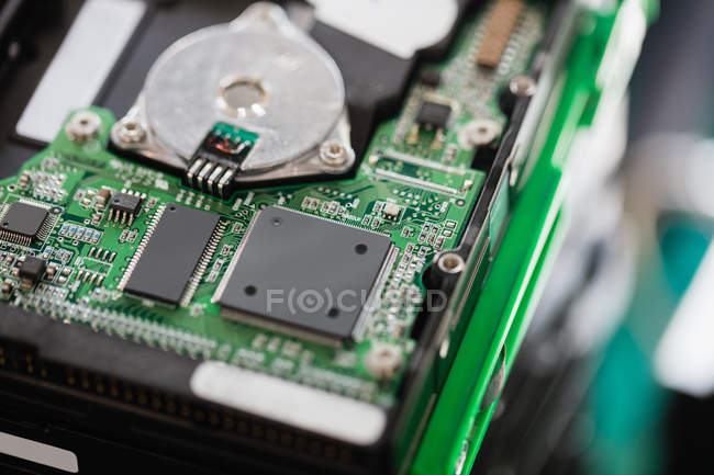 Close-up of an opened hard drive in repair shop — Stock Photo