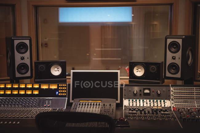 Sound mixer, speakers and equipment in music studio — Stock Photo