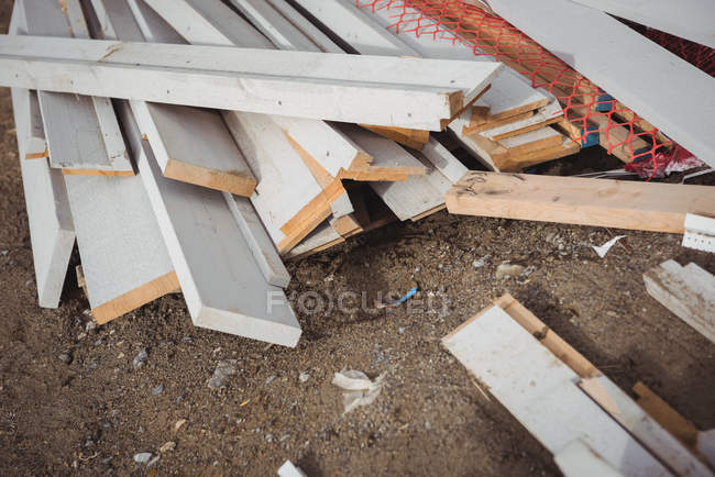 Heap of wooden planks at construction site — Stock Photo
