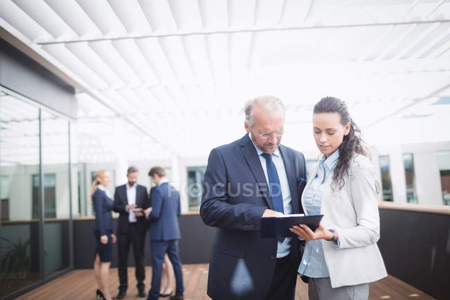 Businessman discussing over document with colleague in office — Stock Photo