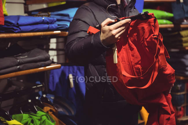 Close-up of man selecting apparel in a clothes shop — Stock Photo