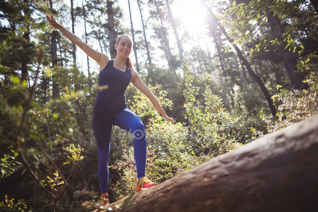 Happy woman posing in forest on a sunny day — Stock Photo