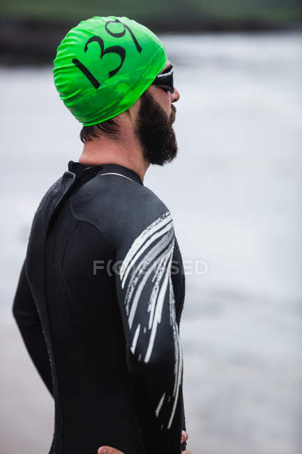 Close-up of athlete standing on the beach — Stock Photo
