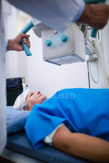 Senior woman undergoing an x-ray test in hospital — Stock Photo