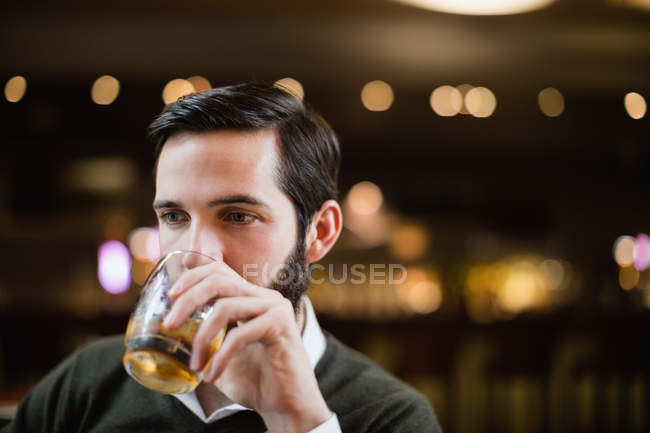Close-up of man having drink in bar — Stock Photo