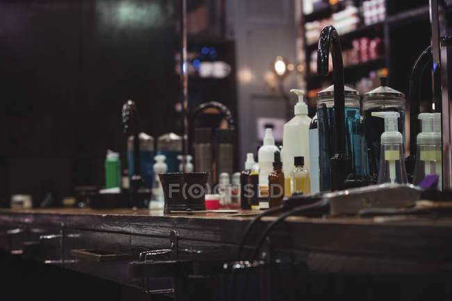 Various beauty products and barber tools on dressing table in barber shop — Stock Photo