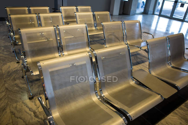 Empty seats in waiting room at the airport terminal — Stock Photo