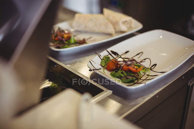 Close-up of food at counter in cafe — Stock Photo