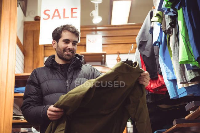 Man selecting apparel in a clothes shop — Stock Photo
