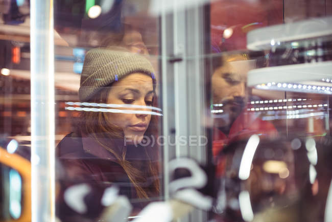 Couple shopping together in a clothes shop — Stock Photo