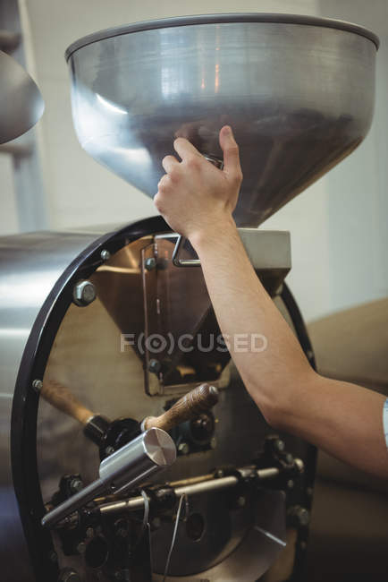 Hand of man using a coffee roaster machine — Stock Photo