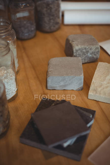 Various stone slab arranged on table in office — Stock Photo
