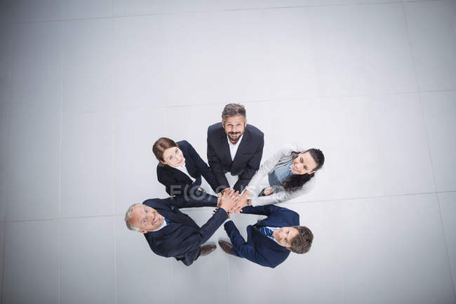 Business people stacking hands together — Stock Photo
