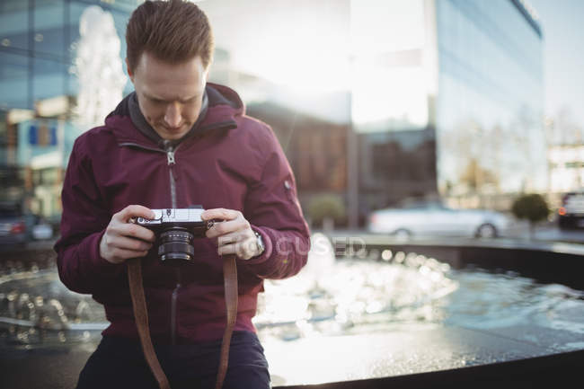 Young male photographer looking at camera at office premises — Stock Photo