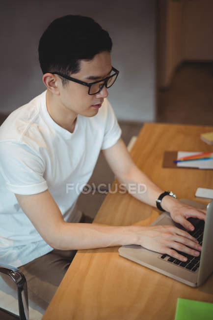 Business executive working on laptop in office — Stock Photo