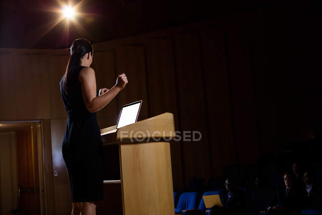 Female business executive giving a speech at conference center — Stock Photo