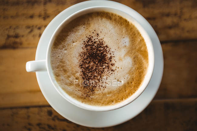 Close-up of coffee cup on table in cafe — Stock Photo