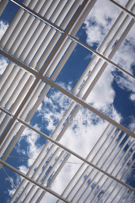View of clouds and sky through office ceiling — Stock Photo