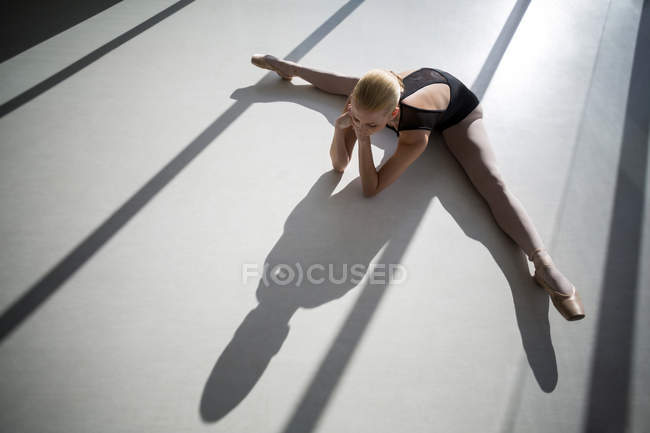 Top view of ballerina stretching on the floor — Stock Photo