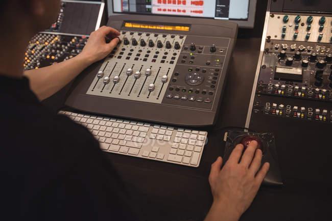 Audio engineer using sound mixer in recording studio — Stock Photo