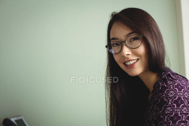 Portrait of business executive wearing spectacles in office — Stock Photo