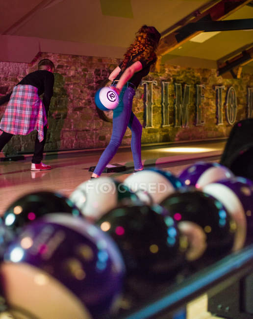 Two friends playing bowling in the bowling alley — Stock Photo